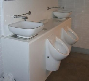 Sink water being used to flush urinals