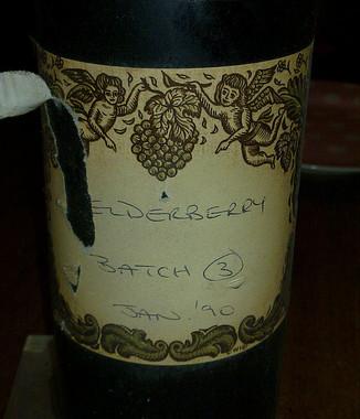 Bottle of homemade elderberry wine